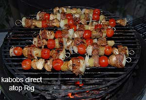 grilling kabobs atop rig in large big green egg.