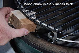 Sliding wood chunks past Adjustable Rig in Large Big Green Egg
