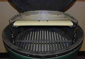 """18"""" cast iron grid on fire with rig holding half stone and grid above, all inside the large big green egg"""