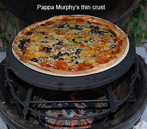 "grilling a pappa murphy's cowboy pizza on the 16"" stone atop the rig extender"