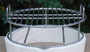 Small woo ring with the grid on top sitting on the big green egg fire ring