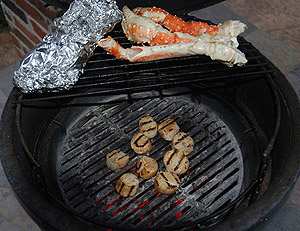 grilling scallops with crabs legs on rig