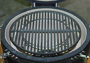 "spider inverted, up, holding an 18"" large cast iron grid in the kamado vision grill"