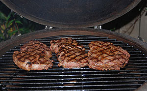 roasting steaks on the woo ring after a sear on kamado vision grill