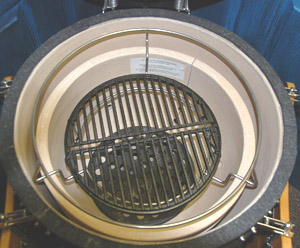 Woo Ring set-up with small cast iron grid for searing close to the lump in a vision classic grill