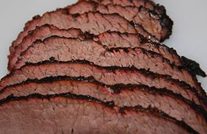 sliced brisket from woo cook in large big green egg