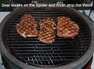 grilling 3 ribeyes on woo in large big green egg