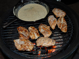 grilling alabama white sauce chicken breast on woo ring in large big green egg