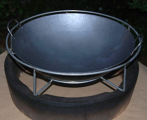 "top view of woo holding a 16"" wok for large big green egg"